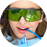 Woman wearing sunglasses at dentist