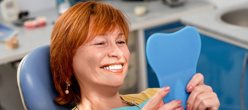 Woman smiling after dental cleaning