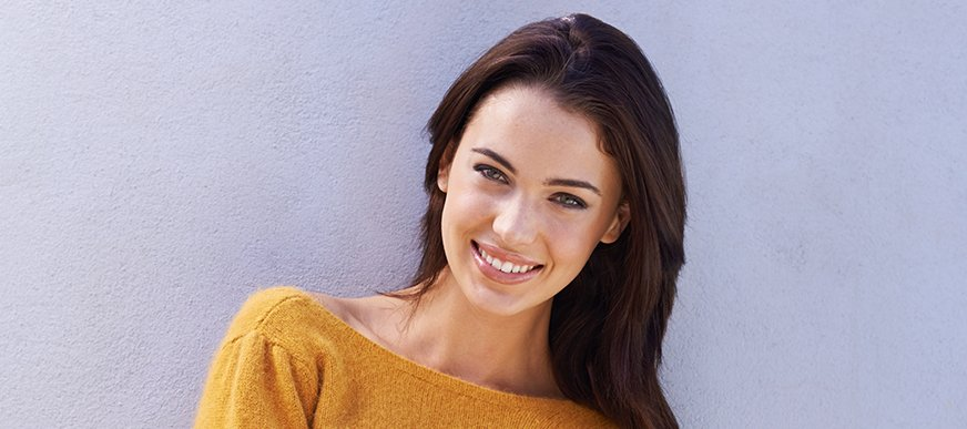 Woman smiling after dental services