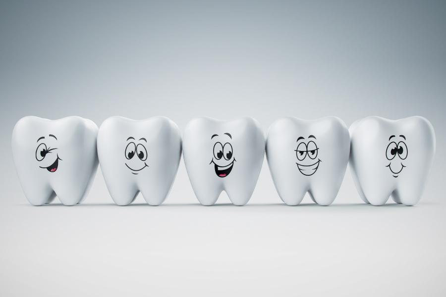 A row of smiling cartoon teeth.